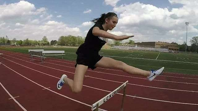 Photo of Scoliosis Patient Jumping Hurdle!